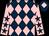 Dark blue and pink diamonds, pink sleeves, dark blue stars, dark blue cap, pink diamond (Mr Simon Treacher)