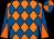 Fluorescent orange and royal blue diamonds, royal blue and orange diablo on sleeves, royal blue and orange quartered cap (SAL IORIO, JR)