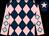 Dark blue and pink diamonds, pink sleeves, light blue diamonds, dark blue cap, pink star (Mrs Yvonne Fleet)