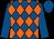 Royal blue and orange diamonds, royal blue sleeves and cap (Winterfields Farm Ltd, M Burton & H Co)