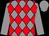 Grey body, red diamonds, grey arms, grey cap (S Guerin/d Huyck/ecurie Sapi)