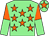 Light green, orange stars, halved sleeves, orange star on cap (John Bernard O'Connor)