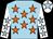 Light blue body, orange stars, white arms, light blue stars, white cap, light blue star (D Miquel)