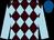 Brown & light blue diamonds, light blue sleeves, royal blue cap (Morten Buskop)
